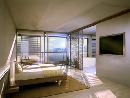 la chambre au design épuré avec son écran plat mural