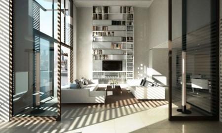 la bibliothèque géante meuble parfaitement l'espace salon