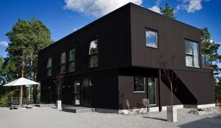 Maison en bois noire Nexthouse