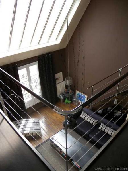 Vue plongeante séjour loft Paris 17
