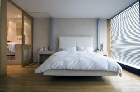 Chambre dans un appartement loft signé Le Corbusier