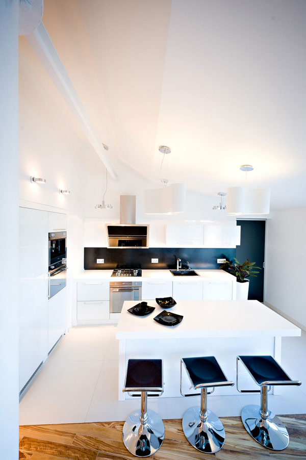 cuisine design blanche dans un loft contemporain. Black Bedroom Furniture Sets. Home Design Ideas