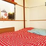 Le lit de la caravane du loft Caravane